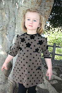 black dot dress with flower applique